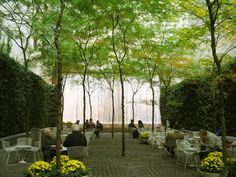 The iconic Paley Park, in the center of Manhattan, with cobblestones, walls of ivy, and a wall of falling water to mask the traffic noise.