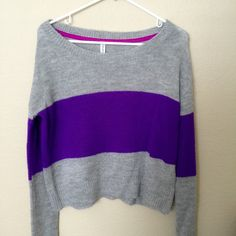 Marled Knit Sweater Purple and grey. Swathe yourself in this sweater and you're sure to stand out wherever you wear it. Complete with a fuzzy marled knit, a relaxed fit, and dropped long sleeves, this super warm pick is a go-to for a luxe, laid-back look. Its boat neckline, chest patch pocket, and small side slits at the hem just add to its effortless appeal. Wear it with black skinnies and buckled booties - on sunnier days, toss it over a shift dress and pair it with sporty, strappy…