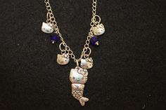 Hello Kitty  Charm Necklace by NelliesTrinkets on Etsy, $18.00