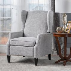 This wing back, traditional recliner is an ideal chair for any room in your home. Featuring a studded border on the sides, this recliner is both stylishand comfortable with its extra padded cushion. This recliner features smooth lines that complement any dcor along with a soft color pallet.Features:Includes: One (1) ReclinerMaterial: FabricFabric Composition: 100% PolyesterLeg Material: BirchColors available in: Charcoal, Navy Blue, Deep Red, Light Grey, or CreamLeg Finish: Dark…