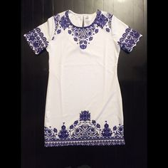 White and Blue Print Mini Dress Brand new!! It a size large, but fits like a small and is super short. I ordered it as a dress for me but it fits like a small tunic. It's brand new and never worn. Dresses Mini