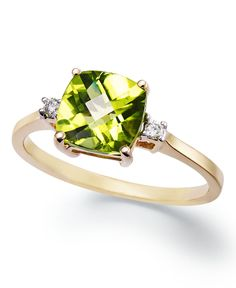 An elegant accent piece in your favorite hue. This exquisite ring features a cushion-cut peridot (1-5/8 ct. t.w.) and round-cut diamond accents at the sides. Set in 14k gold. | Photo may have been enl