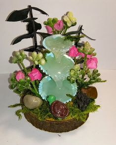 """Give your fairies and gnomes a place to relax with nature. This miniature handcrafted waterfall is handmade from sea shells, hot glue, and polymer clay and other materials, 2""""x 2""""x 3.5"""""""