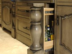 Get Creative With Custom Cabinets...When you're designing custom cabinets, remember that you don't have to choose a door or drawer front to complete the look. Here, cooking oils are hidden behind an architectural feature right by the stove. Design by Dave Stimmel