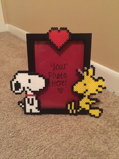 A personal favorite from my Etsy shop https://www.etsy.com/listing/265176943/snoopy-and-woodstock-picture-frame