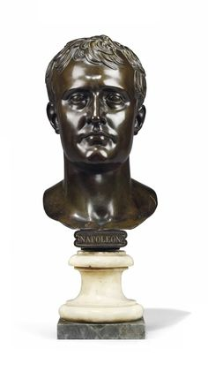 A FRENCH BRONZE PORTRAIT BUST OF NAPOLEON BONAPARTE AFTER A MODEL BY ANTOINE-DENIS CHAUDET (1763-1810), EARLY 19TH CENTURY Cast with inscription 'NAPOLEON', mounted on a white marble socle and grey marble plinth - Dim: 25 ¼ in. (64 cm.) high