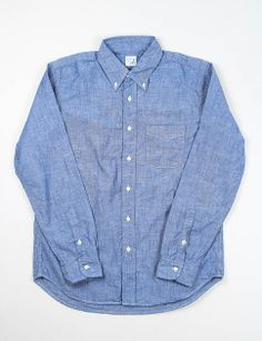 orSlow - Blue Chambray BD Shirt. Button down chambray shirt with a V–stitched chest pocket, curved hem and single button cuffs. 100% Cotton. Made in Japan.