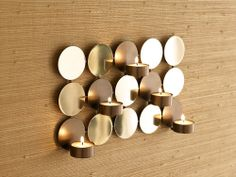 MIRRORED WALL SCONCE when lit, the mirrors reflect the candlelight for a magical look. Holds 5 tealight candles (sold separately) ~ Only $9.95!