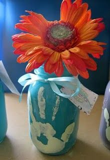 Mason jar, swirl paint inside, pour out paint & dry, then handprint on the outside.  Tie on a ribbon, add a fake flower, and DONE.  Great for gifts =)   So easy & cute!