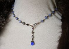 One of a Kind - iolite and each one is wrapped in wire, so the chain is hand made of wire wrapped and the stone, something extra I haven't done before. The drop is Chalcedony, there are vintage beads, and 1 single lavender pearl, you can hook it anywhere and layer for a more dramatic look