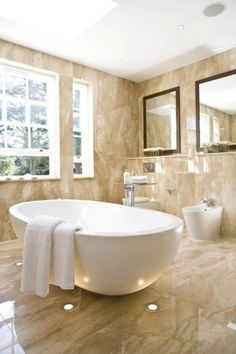 Luxury bathroom in beige marble with a white bathtub with#marble #floor #bathroom #interior #naturalstone