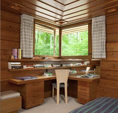 Pew House: Cypress ceiling panels, corner windows, and a built-in desk with shelves draw the eye into the master bedroom.