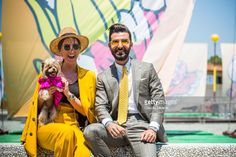 Little Lola Sunshine the dog with a neon silk dress inspired by Off-White, Bugse Kam in a yellow tailleur and Melik Kan, are seen during Pitti Immagine Uomo 92. at Fortezza Da Basso on June 13, 2017 in Florence, Italy.