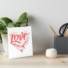"""Buy """"Love Never Gives Up"""" Art Boards #redbubble #quotes #artboards #sayings #motivation"""