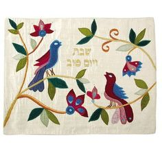 "Raw Silk Appliquéd Challa Cover - Birds & Gold by Yair Emanuel. $54.96. This beautiful artwork will add a touch of color and distinction to your Shabbos or Yom Tov table. The Challah cover is made of raw silk appliqu'd and attached with embroidery. It is beautifully decorated with an elegant illustration of two birds perched on a tree, along with the words ""Shabbat Ve Yom Tov"" (Shabbat and Holiday) embroidered in Hebrew in golden thread over a white background. This is the idea..."