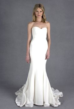 """Brides.com: Wedding Dresses We Love For Under $1,500. A no-frills, body-hugging mermaid gown is a classic choice for the minimalist bride.   """"Dakota"""" wedding dress, $1,035, Nicole Miller  See more Nicole Miller wedding dresses."""