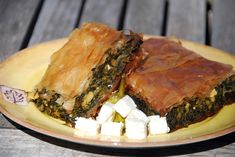 Spinach pie with cubed feta cheese ''Spanakopita'' in greek Spinach Pie, Spinach And Feta, Moussaka, Greek Desserts, Greek Recipes, Phyllo Dough Recipes, Greece Food, Greek Restaurants, Greek Dishes