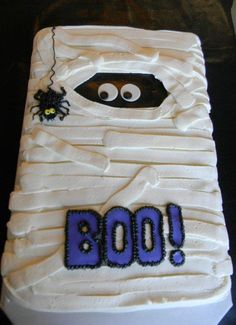 Two full sheets marble cake, double stacked. Iced with buttercream and an icer tip. Fondant embellishments and a buttercream spider.