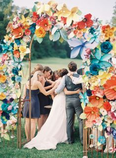 Giant Paper Flower Arch captured by Rylee Hitchner | 10 Paper Flower Backdrops