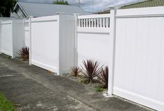A high white wooden fence, reminds me of a bedhead.