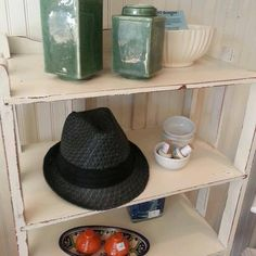 Many fedoras still left, and so is this white shelf with wonderful storage.
