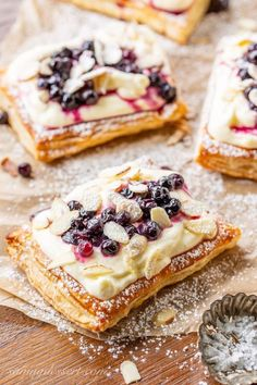 Blueberry Puff Pastry Tarts with Lemon Cream Blueberry Puff Pastry Tarts with Lemon Cream,Yum. Blueberry Puff Pastry Tarts with Lemon Cream, toasted almonds and powdered sugar appetizers and drink pastry recipes cabbage rolls recipes cabbage rolls polish Just Desserts, Delicious Desserts, Yummy Food, Greek Desserts, Gourmet Desserts, Summer Desserts, Tart Recipes, Sweet Recipes, Pastries Recipes