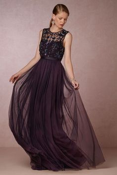 Elegant dark purple sleeveless bridesmaid dress with pleated sheer tulle skirt; Featured Dress: BHLDN