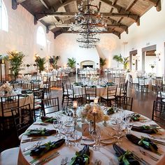 Cream wedding reception decor with chandelier and palm trees at Montecito Country Club (Melissa Musgrove Photography)