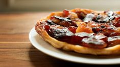 Tarte Tatin isn't as American as apple pie, but it's a whole lot easier. With just four ingredients, it's all about the apples: the lovely taste and shape of the fruit are preserved by sugar and heat, with a buttery-salty crust underneath. This recipe from Gotham Bar and Grill in New York has a couple of tricks that make it easier to pull off than others. (Photo: The New York Times)