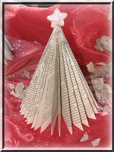 This folded book page tree was brushed with @Helmar Gemstone Glue then sprinkled with glitter. #Gemstoneglue