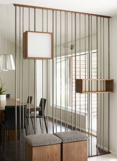 A room divider created with metal rods.