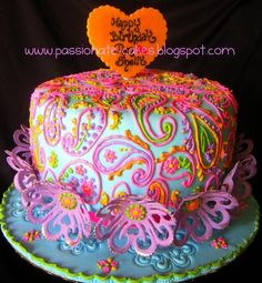 Paisley Cake The cake artist layers wild and exotic colors in paisley designs on top of a subtle pastel fondant cake. This whimsical cake has us yearning for the 70s.