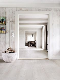 Wooden planks wallpaper in naturals and plenty of awesome space in this German summer house