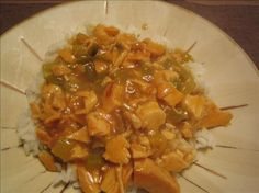 Emeril s Chicken Etouffee from Food.com:   Great New Year's Day recipe.  Served this with collard greens (for money) and black-eyed peas (for luck).  From Paula Deen's magazine.