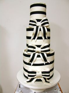 "B stripe 3 tier.  8""x6"",6""x6"",4""x6"".  The fondant is wrapped around each tier with the stripes already on.  Bows half fondant and gumpaste. TFL"