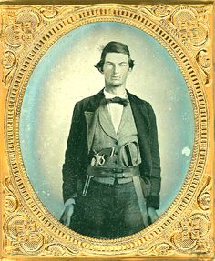 (c. 1861-1865) A rebel with a Colt Army revolver stuffed in his belt as well as a double D Guard Bowie knife.