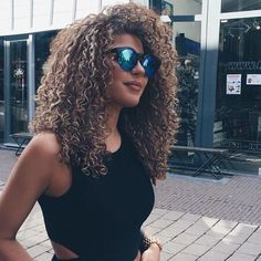 Relaxed Brown Curly Hair w. Blonde Highlights.