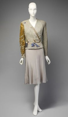 'Cocteau' evening jacket | Elsa Schiaparelli (Italian, 1890-1973) | France, Autumn 1937 | Linen, metallic foil, beads, paillettes | Schiaparelli's involvement with Dada an Surrealist artists resulted in some of the most renowned works of 20th century haute couture. This jacket, with its trompe-l'oeil profile, was a product of her collaboration with Jean Cocteau | The Metropolitan Museum of Art, New York