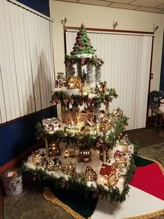 Christmas village built on tiered wooden bases Christmas Tree Village Display, Christmas Nativity Scene, Old Christmas, Christmas Villages, Christmas Projects, Holiday Crafts, Vintage Christmas, Christmas Ornaments, Holiday Decor