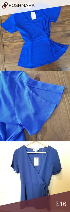 NWT royal blue tie waist wrap blouse Unworn new with tags, royal blue tie waist wrap blouse top by Pink Rose. Butterfly sleeves with slits.  Two clasps for closure plus tie. V neck  More toward junior sizing Pink Rose Tops Blouses