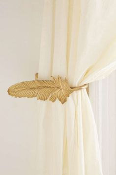 25 Decor Pieces Under $50 to Glam Up Any Room: URBAN OUTFITTERS FEATHER CURTAIN TIE-BACK. Your kids may lose a hide-and-seek spot, but tying back your curtains looks oh so chic. ($16 or 2 for $25; Urban Outfitters)