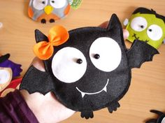 bat girl purse @ lovelia on etsy....might be able to make with felt and hot glue....too cute