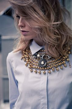 Layer over-the-top statement jewelry to reinvent your button down.