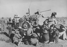 A group of British prisoners at Marmon-Herrington armored cars (in the foreground - Marmon-Herrington Armored Car Mk.II, in the background - Marmon-Herrington Armored Car Mk.III) in North Africa. In the background of the photo - the German soldiers.
