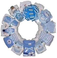 """diaper wreath """"decorated"""" with gifts for baby.....awesome baby shower gift idea!"""
