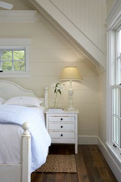 I'm loving the white, fresh interior of this cottage home, with the black accents and the dark wood floors