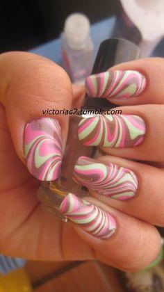 Pink n green n brown water marbled nails.