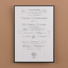 Elegance is key with this white moiré layered invitation featuring a black shimmer backer card.