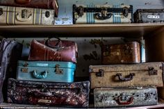 Rows of suitcases stuffed full with confiscated belongings have been left in one of the dilapidated rooms, the contents of which are destined to never be unpacked. The names on some of the cases can still be made out