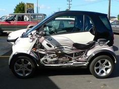 Not because he likes smart cars, though he has nothing against them...but the motorcycle makes me think of him